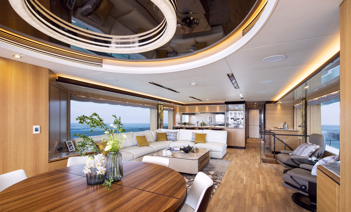 The salon reclaims some aft deck space for indoor dining. The table extends to seat 10.