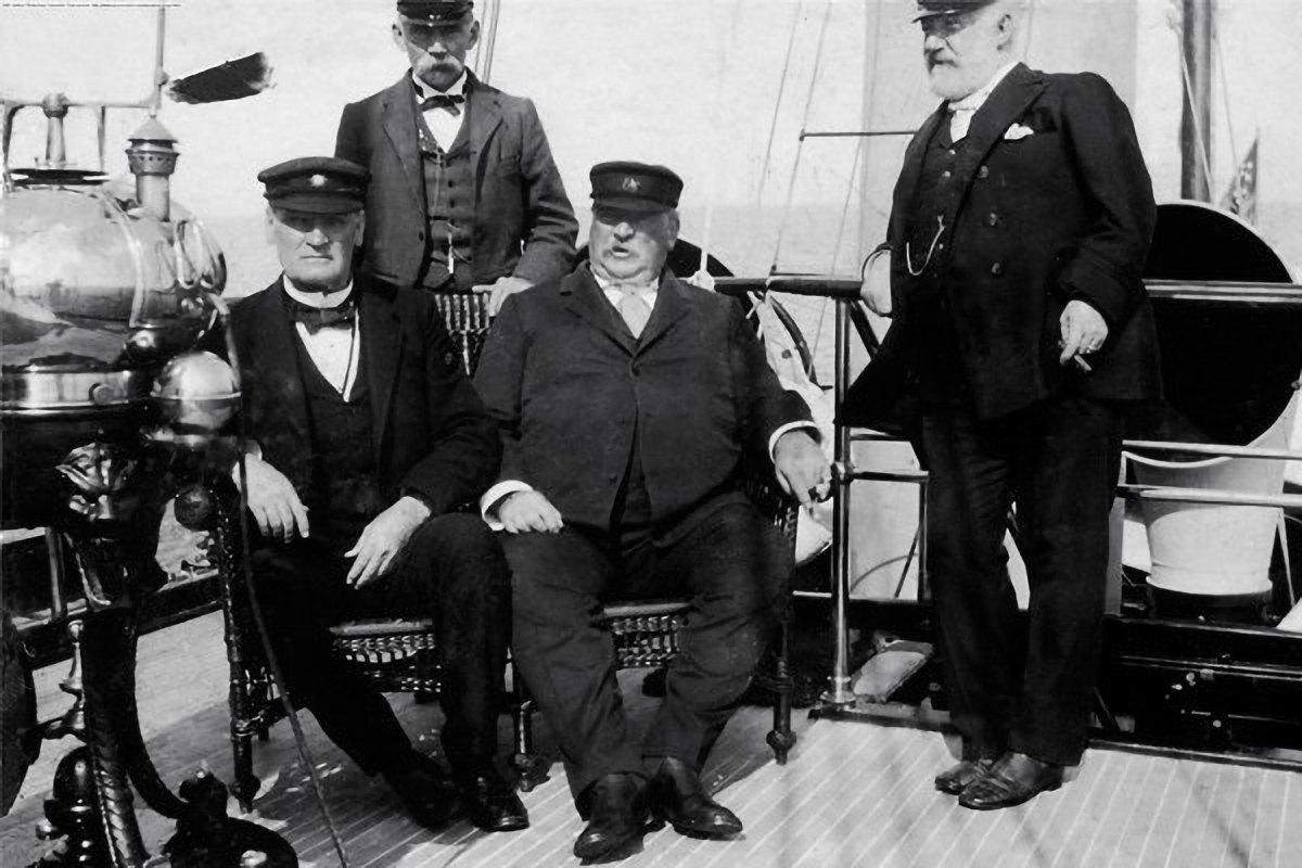 Cleveland (seated, center), aboard Oneida.