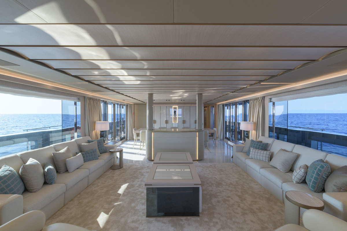 The yacht's contemporary décor is based on the bright and natural nuances of wood and off-white textiles combined with more opulent onyx, leather and bronzed metallic accents.
