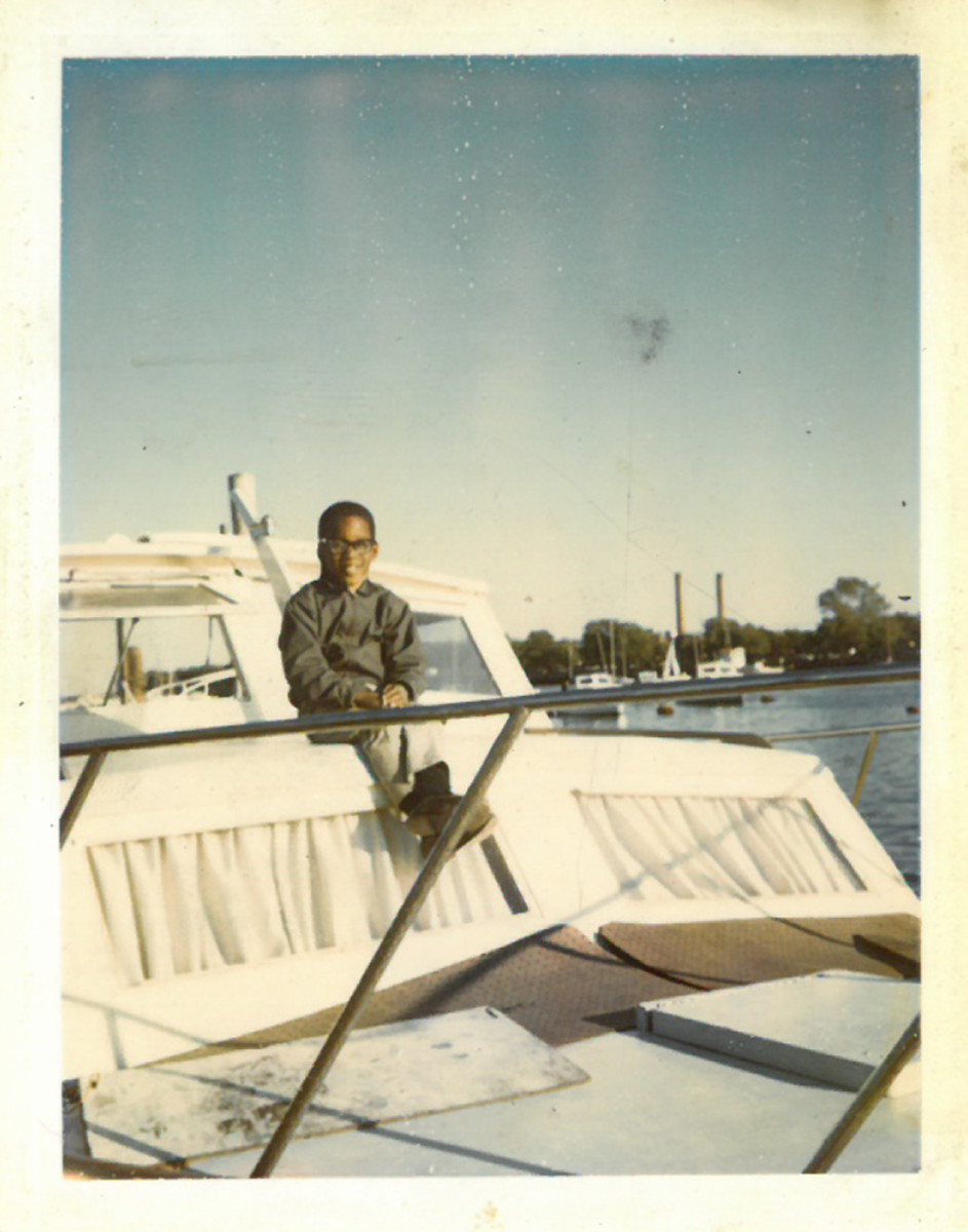 Marshall as a young boy aboard his family's cabin cruiser.