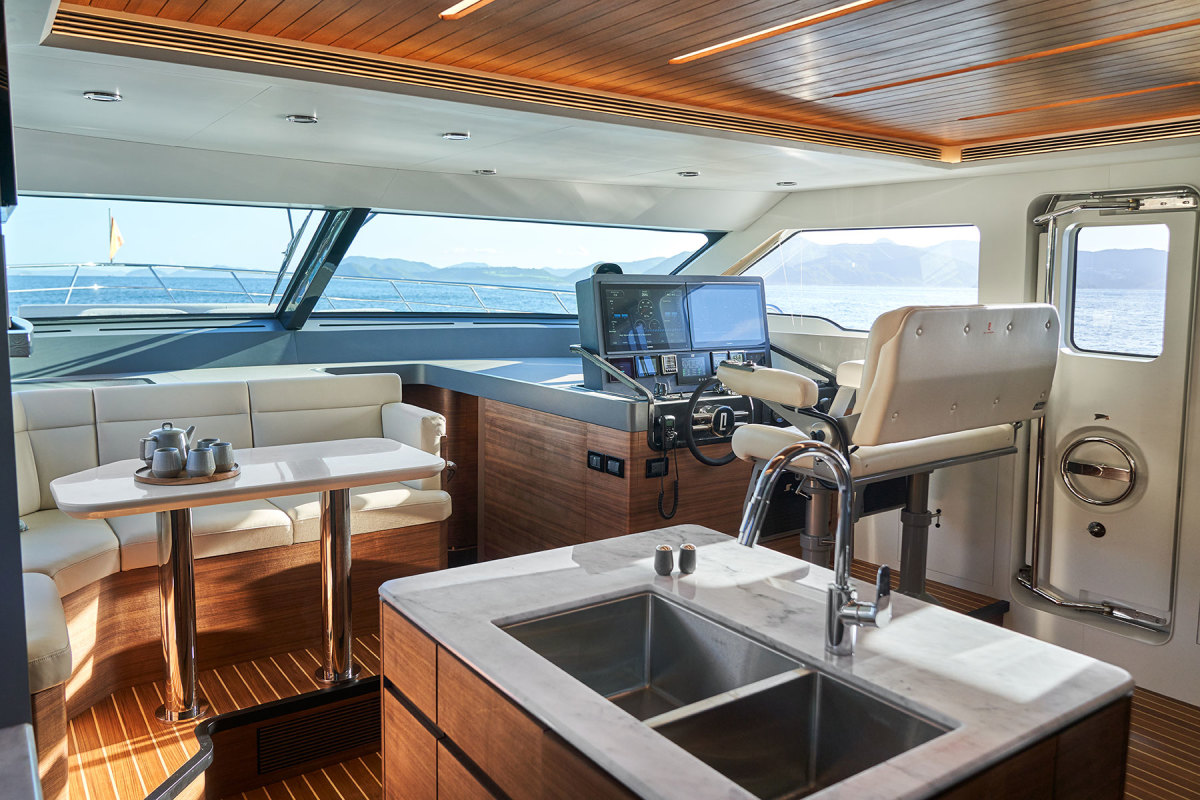 A breakfast nook forward of the galley benefits from excellent natural light.