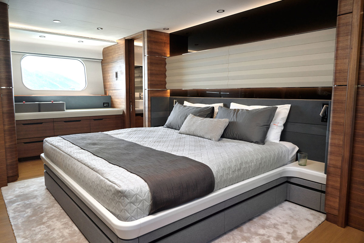 A king-size berth is the focal point of a full-beam, amidships master stateroom.