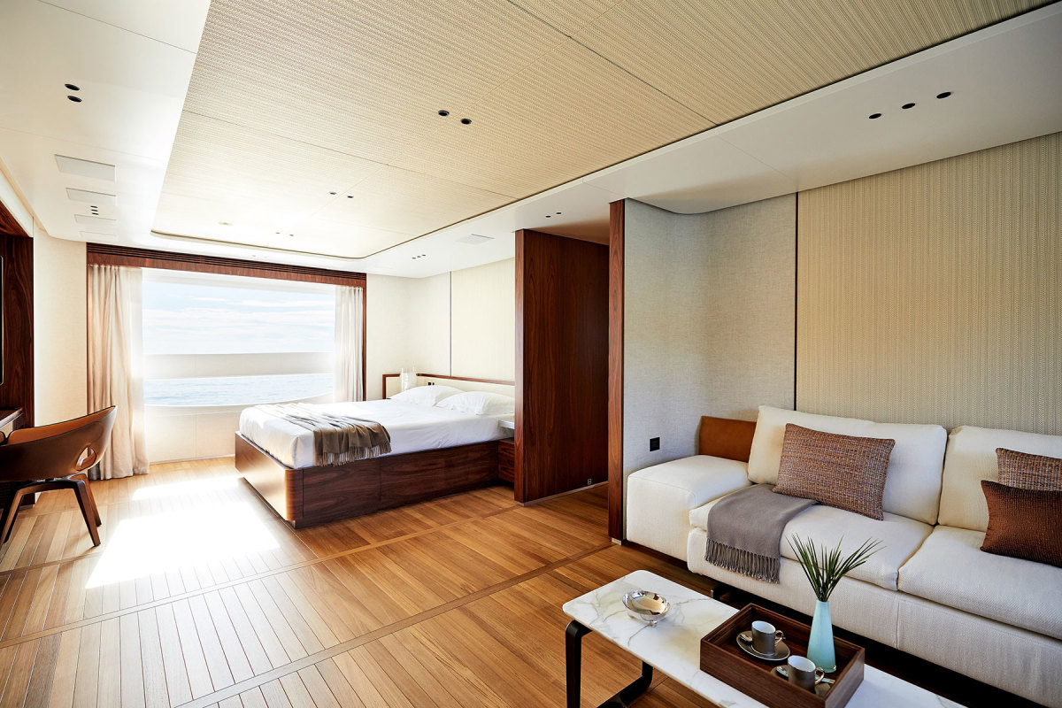 The owner's suite continues the design theme of natural light, wide-angle views and wood soles.