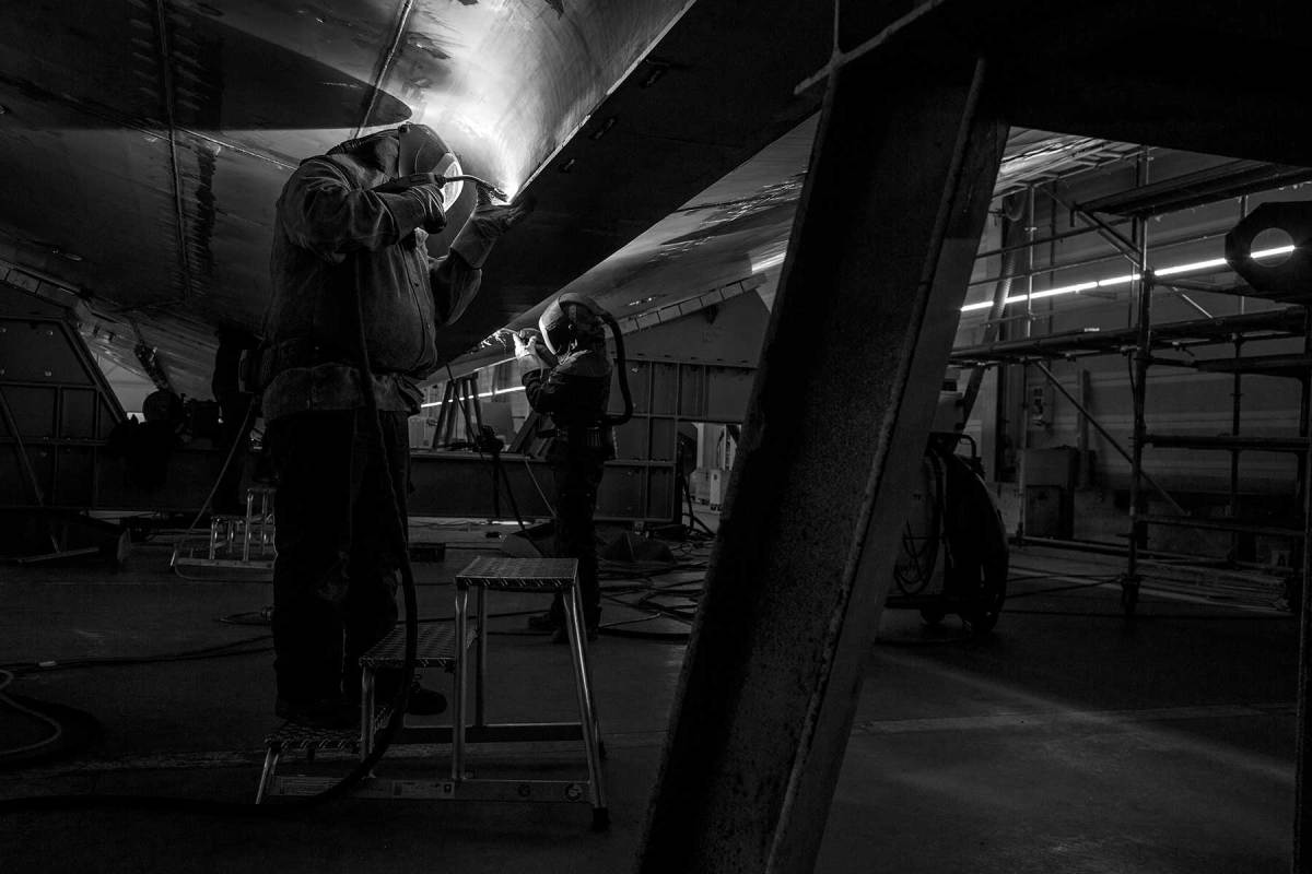 A pair of welders at work on Project Cosmos,  Heesen's largest yacht to date.