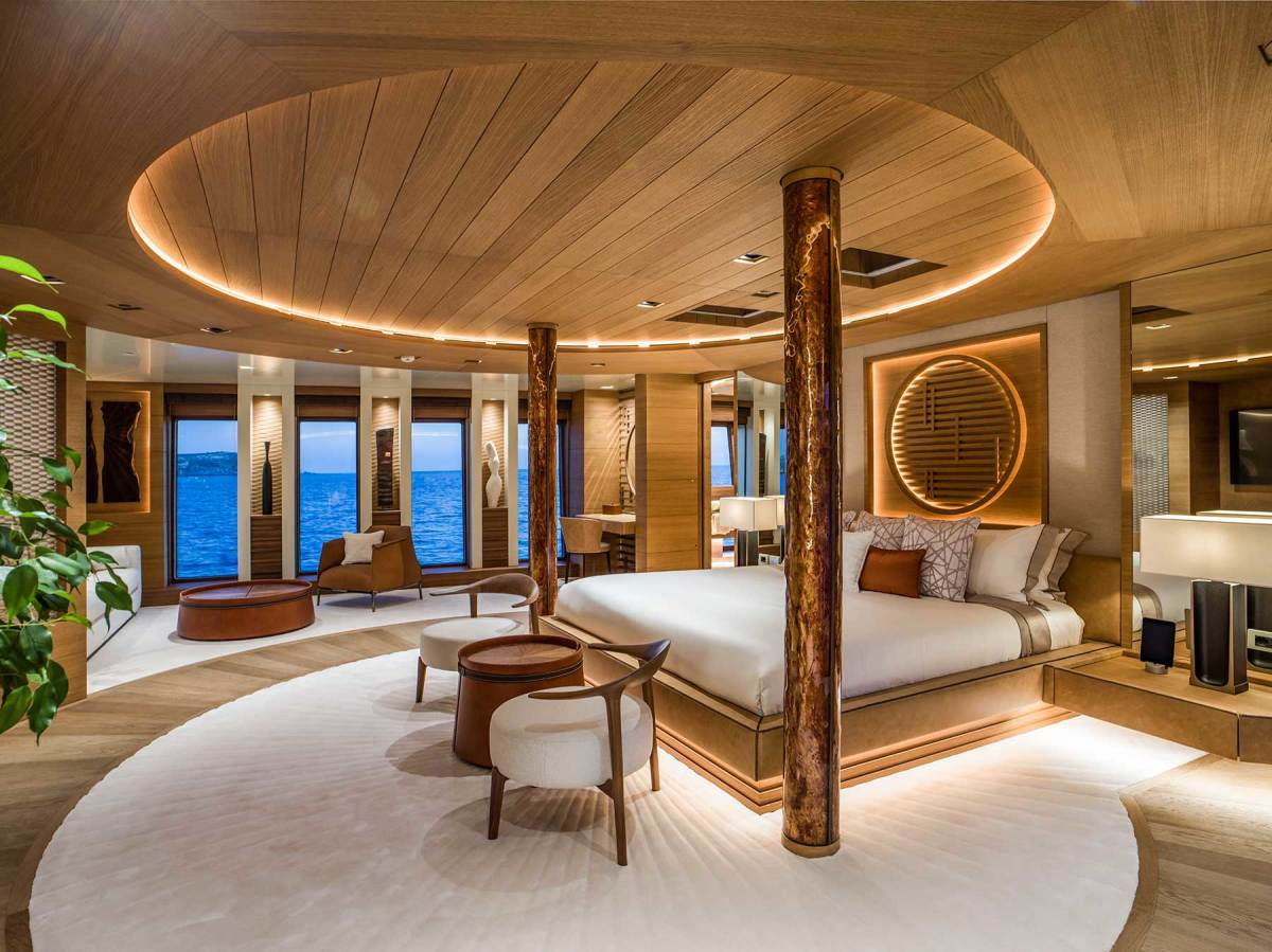The master stateroom on the main deck forward showcases interior designer Mark Berryman's penchant for brushed veneers and Japanese motifs. The cladding on the pillars is Murano glass.