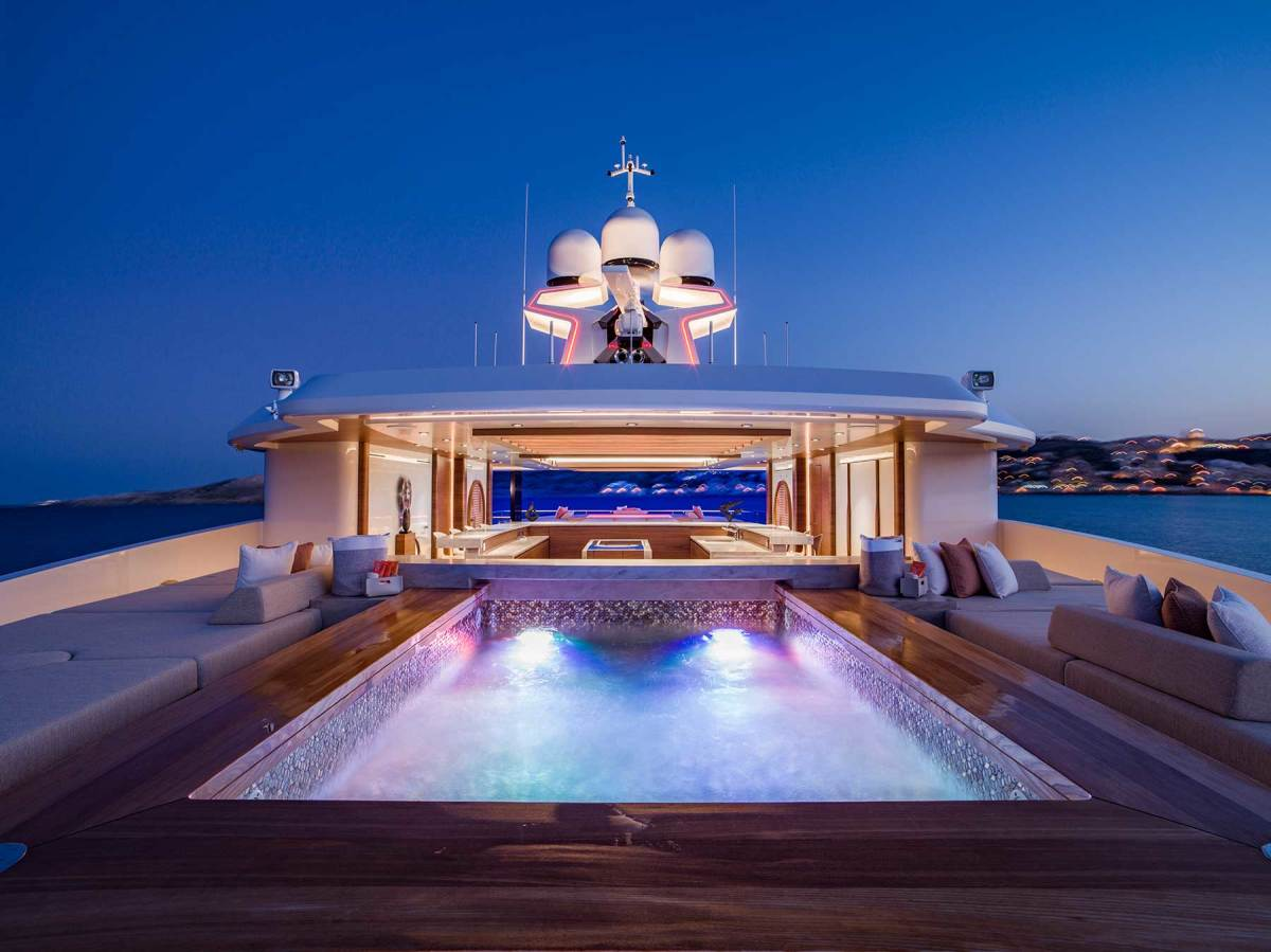 The largest of the yacht's three pools, on the sundeck. Facing: The signature break in the bulwarks creates a two-story expanse of glass.