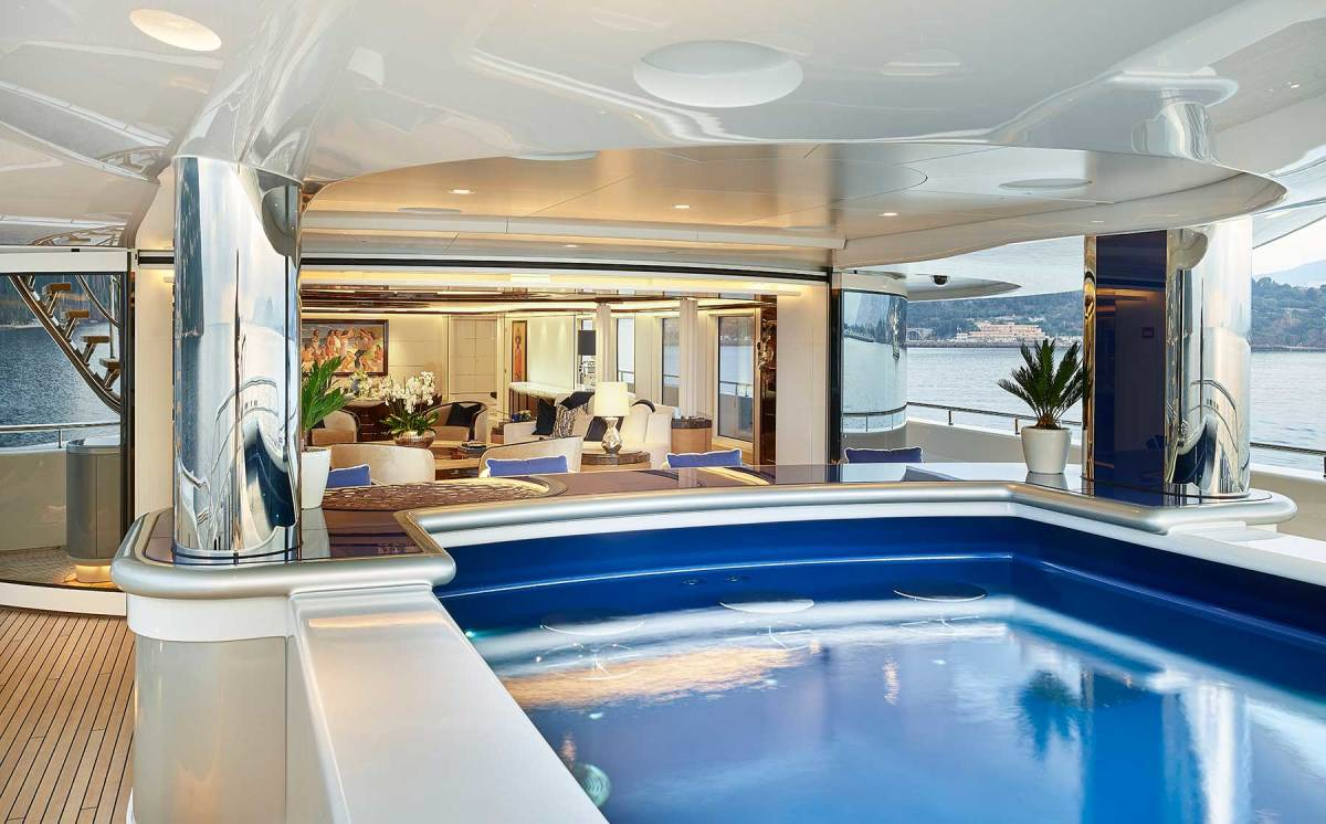 The main deck pool's glass bottom illuminates the beach club below