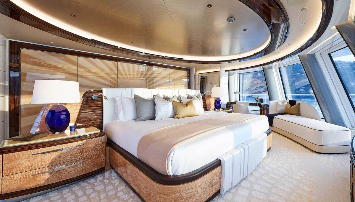 The owner's suite features macassar ebony paneling, wool carpets with crocodile pattern, and a high-gloss inlaid sunburst headboard.