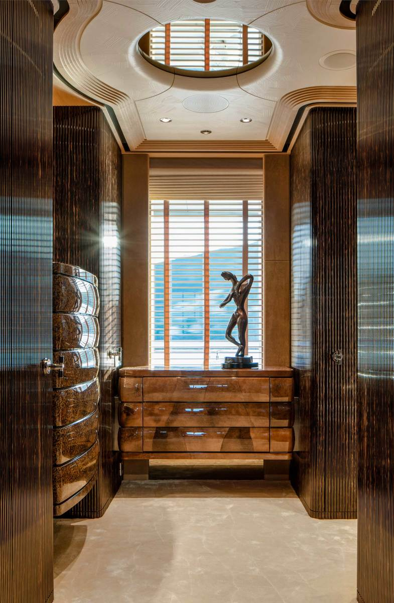 Interior designer Terence Disdale created a dressing area with high-gloss, lacquered finishes and exotic woods.
