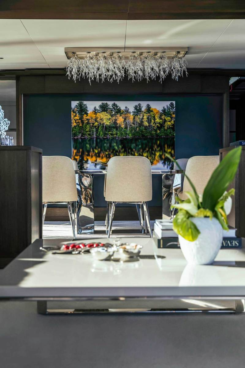The eight-seat formal table is one of three dining areas on the Sirena 88.
