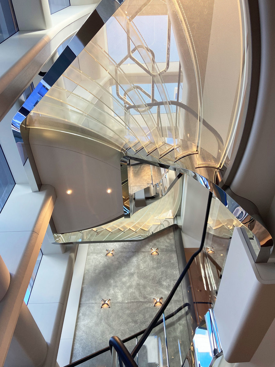 Harrison Eidsgaard created this stunning stairwell as a focal point for the overall interior design of the 2021 235-foot (72-meter) Feadship Vanish.