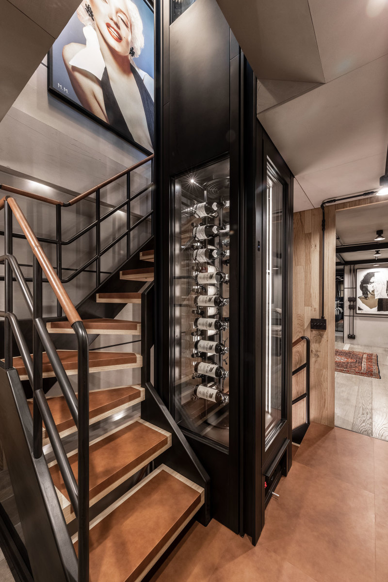 A centerpiece is the two-deck wine rack modeled to resemble an elevator.