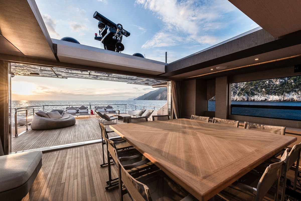 The interior dining table has been shifted from the main salon to the fly deck under a moonroof for dining under the stars.