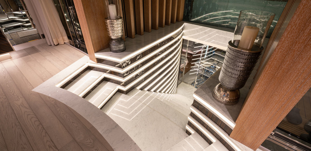 The lower deck beach club, which includes a swimming pool, sauna, gym and cinema, can be reached via this indoor staircase, which is unusual because it originates in the main salon.